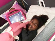 Genell in her SleepSafe Bed